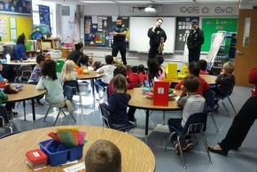 Photos of firemen visiting kindergarten