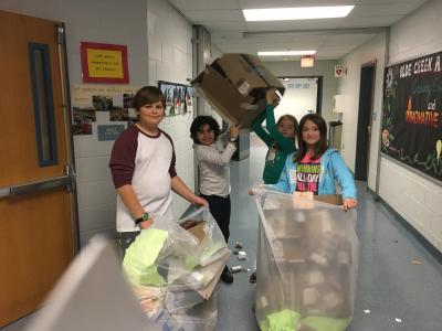 photo of students recycling