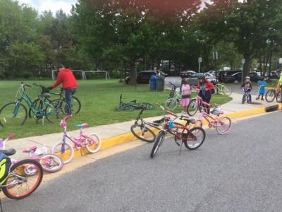 photo of students riding their bikes to school